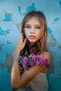 Portrait Of A girlholding a lilac branch Royalty Free Stock Photo