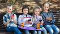 Portrait of girls and boys playing with phones outdoor Royalty Free Stock Images