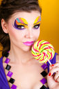Portrait of a glamourous woman holding lollipop Stock Photos