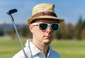 Portrait of a golfer man with hat and sunglases Stock Photography