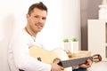 Portrait of goodlooking guitarist Stock Photos