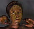 Portrait gorgeous young woman covered gold glitter Stock Photo
