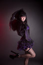 Portrait of gothic lolita girl with umbrella studio shot on black background Royalty Free Stock Images