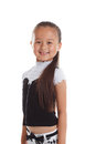 Portrait of graceful little girl smiling in studio close up Royalty Free Stock Photo