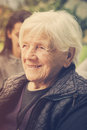 Portrait of a grandmother daydreaming face only closeup retro colors Royalty Free Stock Photography