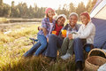 Portrait of grandparents with children camping by lake Royalty Free Stock Photo