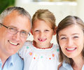 Portrait of grandparents with granddaughter Royalty Free Stock Images
