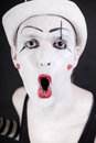 Portrait grimace mime in white hat on black background close up Royalty Free Stock Photo