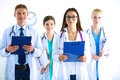 Portrait of group of smiling hospital colleagues standing together Royalty Free Stock Photo