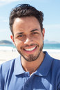 Portrait of a guy with beard and blue shirt at beach Royalty Free Stock Photo