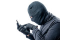 Portrait of a hacker with a stolen mobile phone on a white Royalty Free Stock Photo