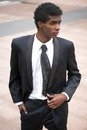 Portrait of a handsome african american fashion model in black suit male Royalty Free Stock Photo