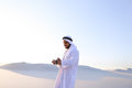 Portrait of handsome Arab businessman who experiencing new iWatc