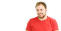 Portrait of handsome bearded young man with beaming smile Royalty Free Stock Photo