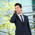 Portrait of a handsome businessman talking on mobile phone outdoors close up Stock Photography