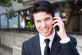 Portrait of handsome businessman using cell phone Stock Images