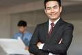 Portrait of handsome confident young businessman smiling Royalty Free Stock Photo