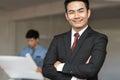 Portrait of handsome confident young businessman smiling