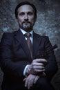 Portrait of a handsome dangerous man