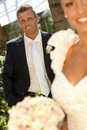 Portrait of handsome groom on wedding day smiling happy outdoor photo Stock Photo