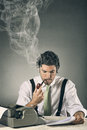 Portrait of an handsome journalist with smoking words grey background and copy space Stock Images