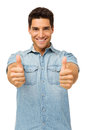 Portrait of handsome man gesturing thumbs up young while standing against white background vertical shot Stock Image