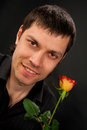 Portrait of handsome man with rose. Royalty Free Stock Photo
