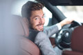 Portrait of an handsome smiling business man driving his car Royalty Free Stock Photo