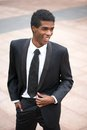 Portrait of a handsome young african american businessman smiling outside outdoors Stock Photos