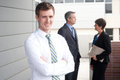 Portrait of a handsome young businessman standing outside office Royalty Free Stock Image