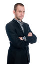 Portrait of a handsome young businessman staring against isolated white background Royalty Free Stock Image