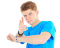 Portrait of handsome young man in casual clothes standing over w Stock Images