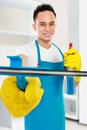 Portrait of handsome young man cleaning the house Stock Image