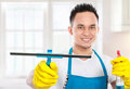 Portrait of handsome young man cleaning the house Stock Photography
