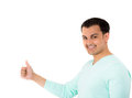 Portrait of a handsome young man showing thumbs up sign against white background Stock Photography