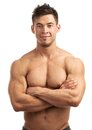Portrait of a handsome young muscular man with great physique posing against white background Royalty Free Stock Photos