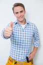 Portrait of a handyman gesturing thumbs up against white background Royalty Free Stock Image
