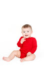 Portrait of a happy adorable Infant child baby girl lin red sitting happy smiling on a white background Royalty Free Stock Photo