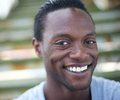 Portrait of a happy africa american man smiling outdoors closeup Royalty Free Stock Image