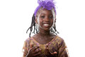 Portrait of a happy African  little girl  in purple costume.Isolated Royalty Free Stock Photo