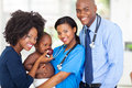 Portrait happy african pediatricians mother baby checkup Royalty Free Stock Images