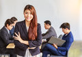 Portrait of happy asian businesswoman, people group in backgroun Royalty Free Stock Photo