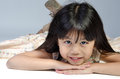 Portrait of happy asian cute girl little on gray background Stock Photography