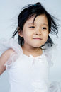 Portrait of happy asian cute girl little on gray background Royalty Free Stock Images