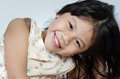 Portrait of happy asian cute girl little on gray background Royalty Free Stock Photo