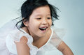 Portrait of happy asian cute girl little smile on gray background Stock Photos