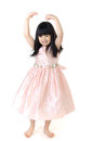 Portrait of happy asian cute gril is dancing on gray background Royalty Free Stock Photography