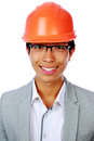 Portrait of a happy asian man in helmet over white background Stock Photos
