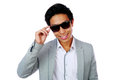 Portrait of a happy asian man in sunglasses over white background Stock Images