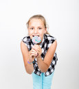Portrait of happy beautiful young girl licking sweet candy and expressing different emotions. pretty teenager girl with Royalty Free Stock Photo